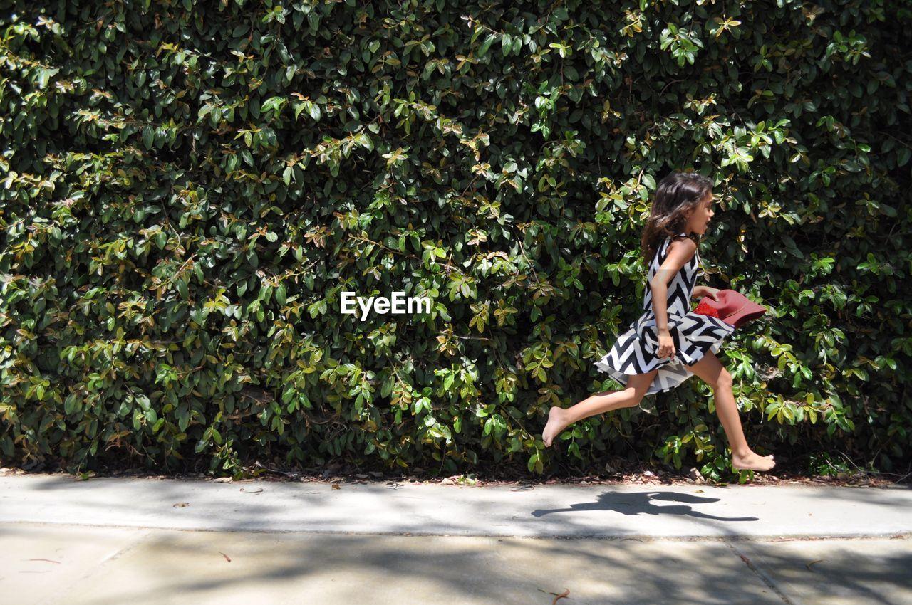 Girl Running On Footpath