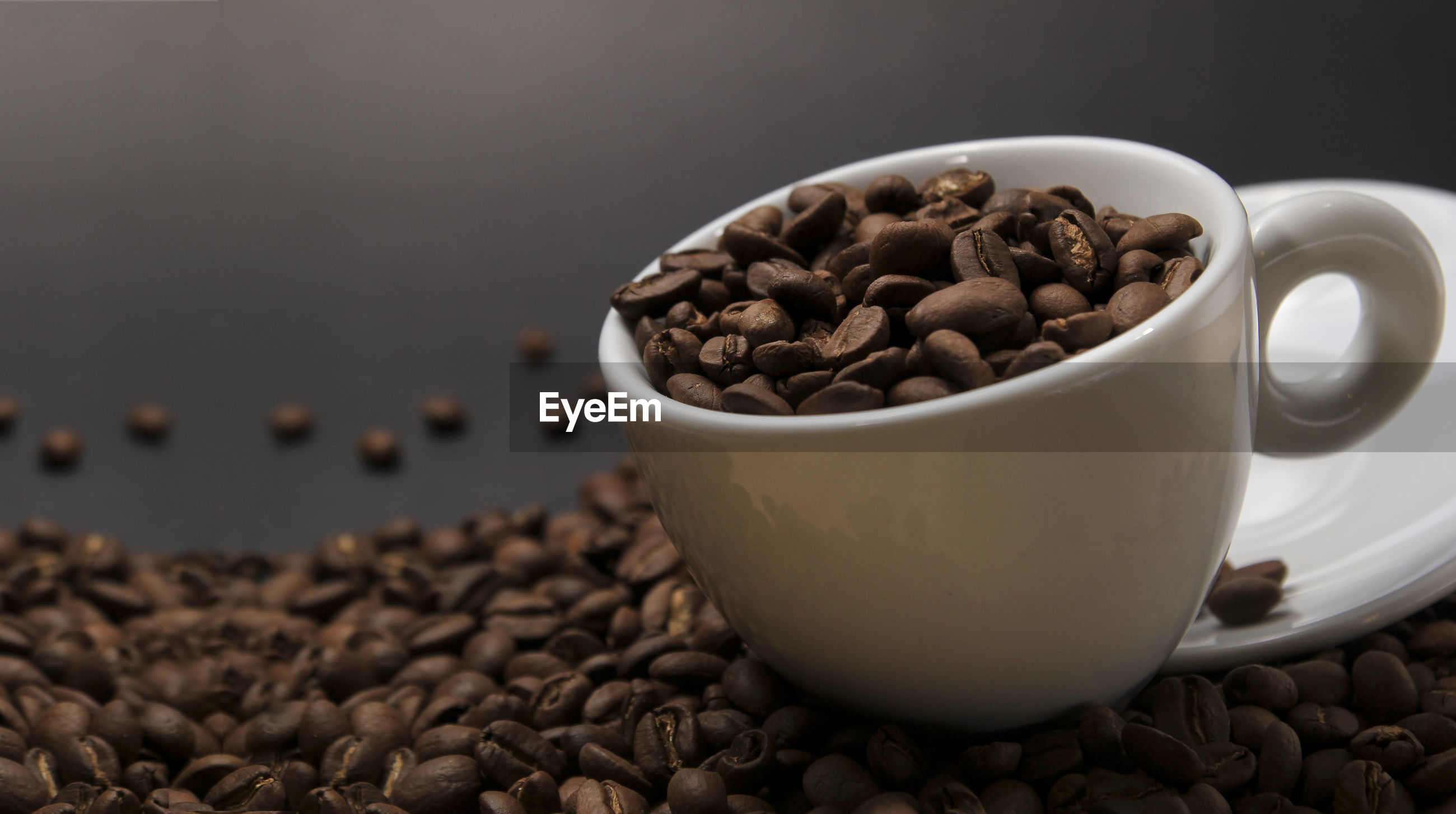 Close-up of coffee cup with beans