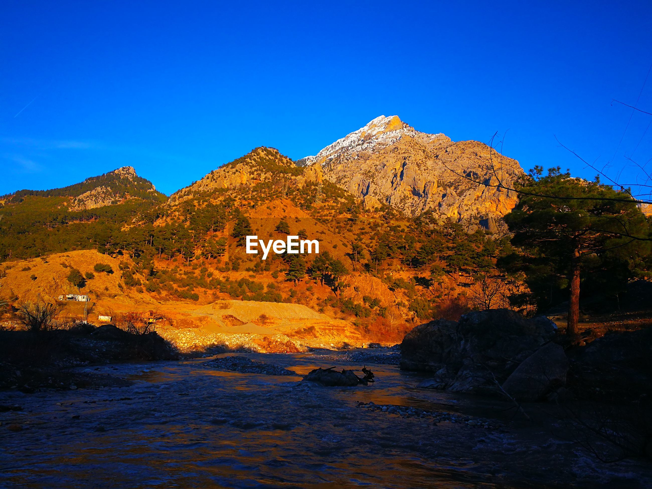 sky, beauty in nature, rock, water, tranquil scene, blue, mountain, tranquility, nature, scenics - nature, rock - object, solid, clear sky, non-urban scene, rock formation, no people, idyllic, land, day, outdoors, formation