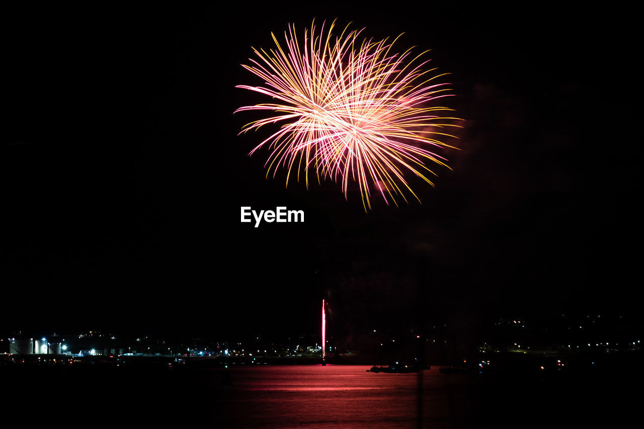 night, illuminated, firework, motion, firework display, arts culture and entertainment, event, celebration, architecture, exploding, sky, building exterior, long exposure, built structure, firework - man made object, no people, city, multi colored, nature, light, outdoors, sparks, cityscape