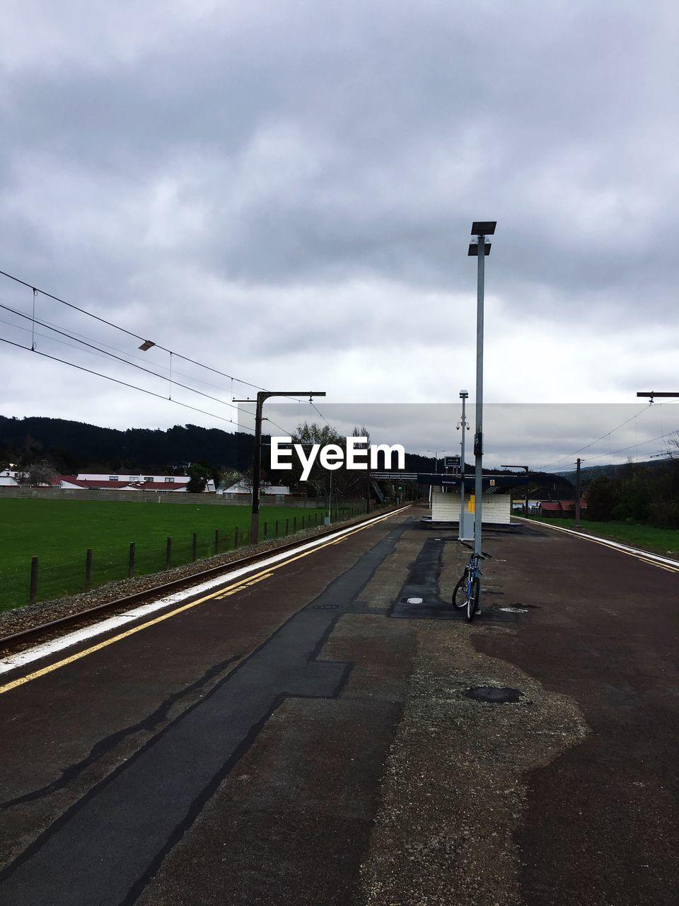 sky, cloud - sky, the way forward, transportation, road, day, street light, outdoors, electricity pylon, no people, nature, tree