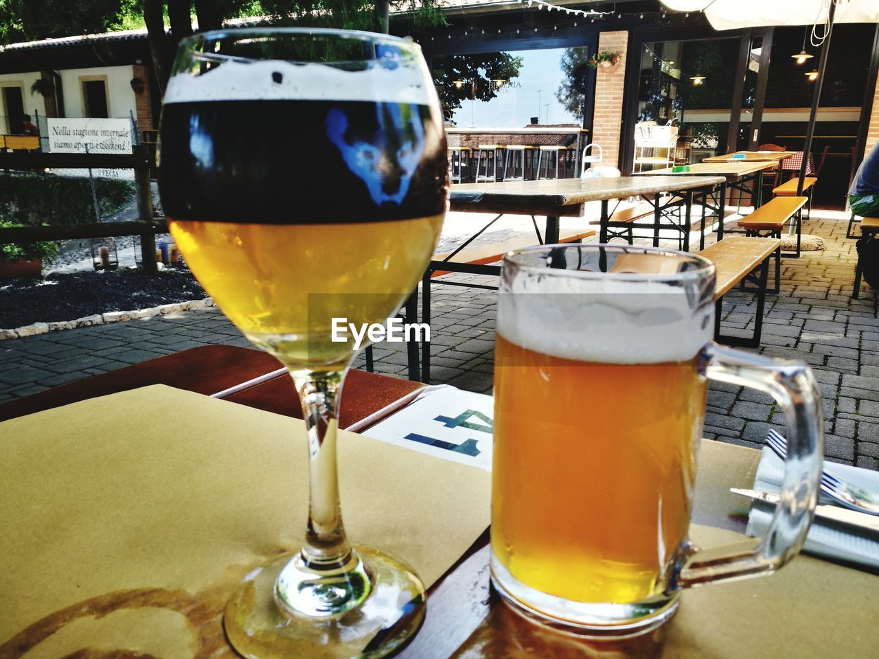 drink, refreshment, food and drink, alcohol, table, glass, beer, beer - alcohol, drinking glass, freshness, restaurant, business, still life, beer glass, household equipment, close-up, no people, frothy drink, food, focus on foreground, pint glass