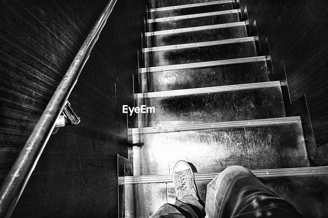 shoe, low section, human leg, personal perspective, one person, human body part, human foot, real people, staircase, steps, men, indoors, lifestyles, steps and staircases, standing, one man only, day, only men, adult, people, adults only