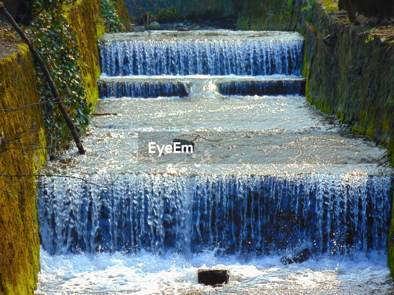 Scenic view of river flowing through landscape