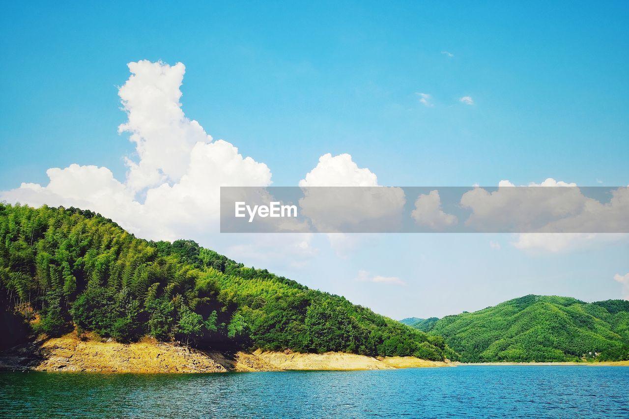 sky, beauty in nature, water, scenics, nature, cloud - sky, tranquility, day, tree, outdoors, lake, no people, tranquil scene, mountain, waterfront