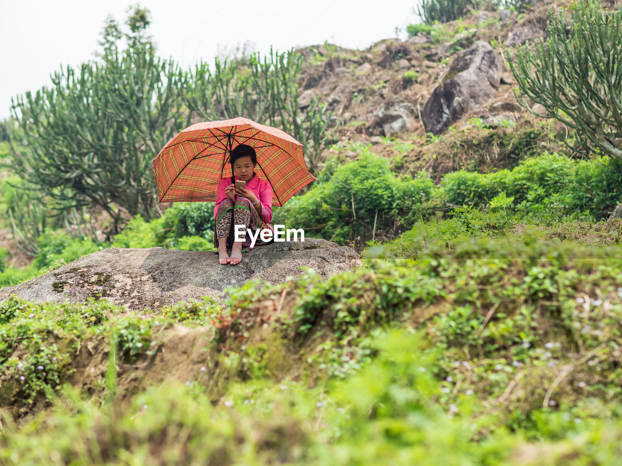 selective focus, nature, people, leisure activity, umbrella, protection, day, plant, adult, full length, real people, adventure, lifestyles, mountain, outdoors, walking, rock, security