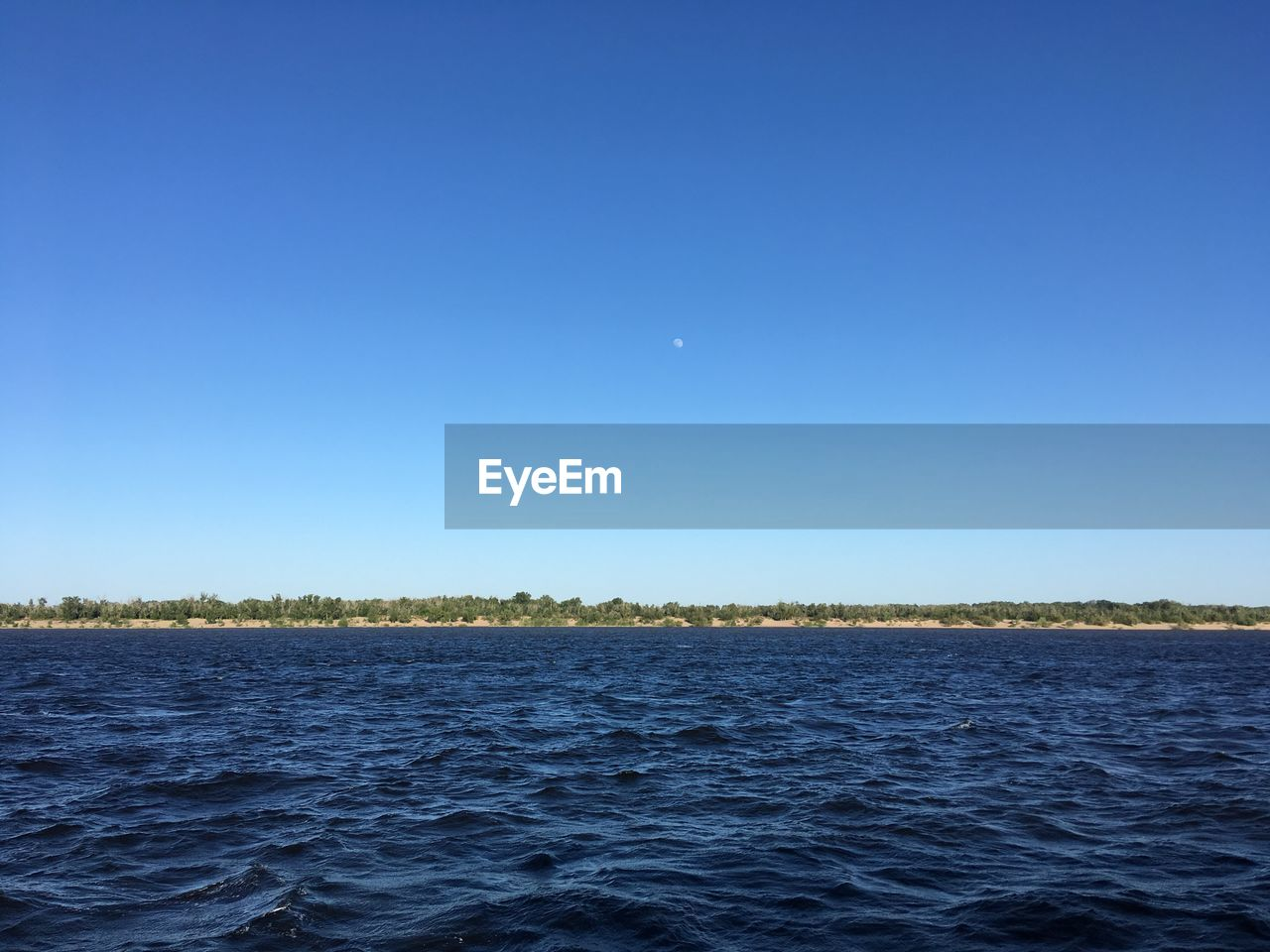 sky, water, blue, clear sky, tranquil scene, tranquility, copy space, beauty in nature, scenics - nature, waterfront, sea, nature, no people, moon, non-urban scene, idyllic, outdoors, day