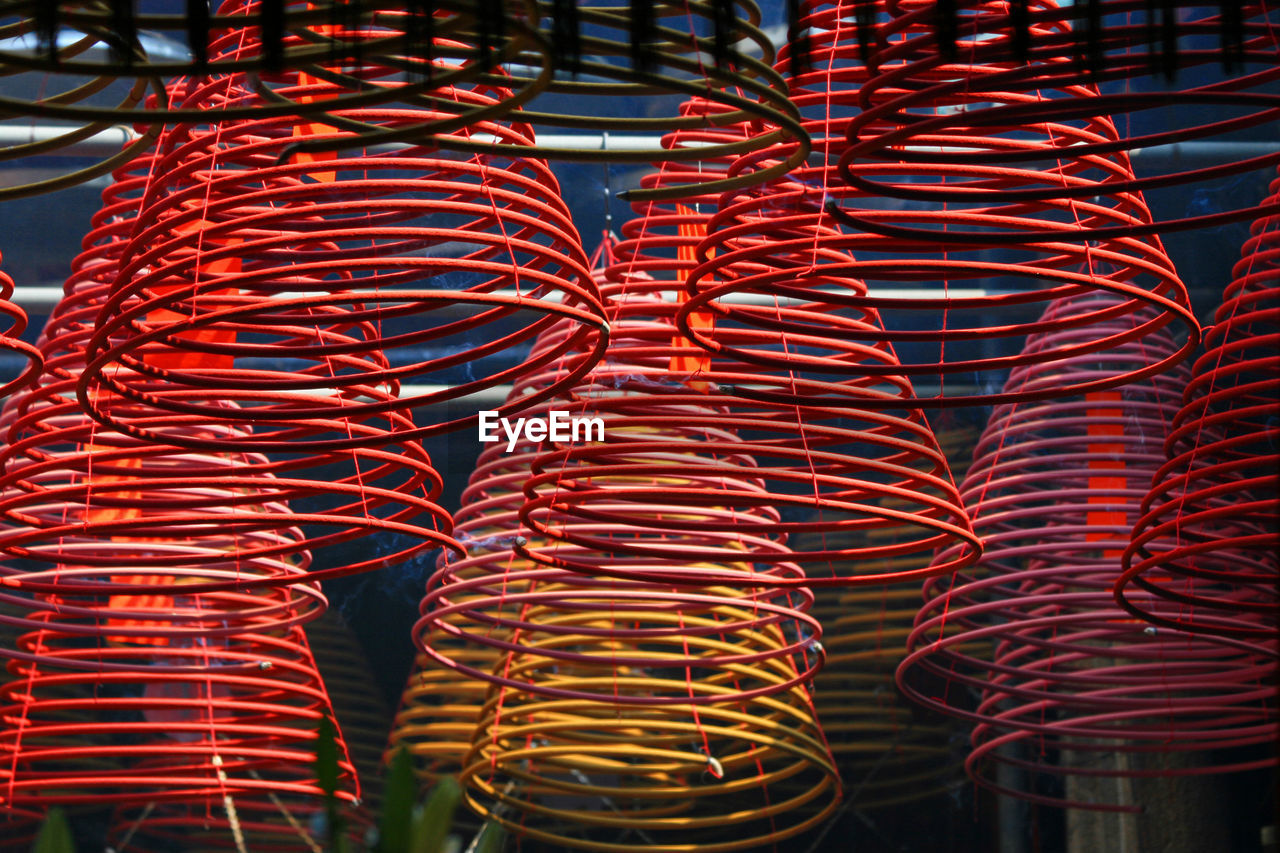 Close-up of spiral shaped incenses in temple