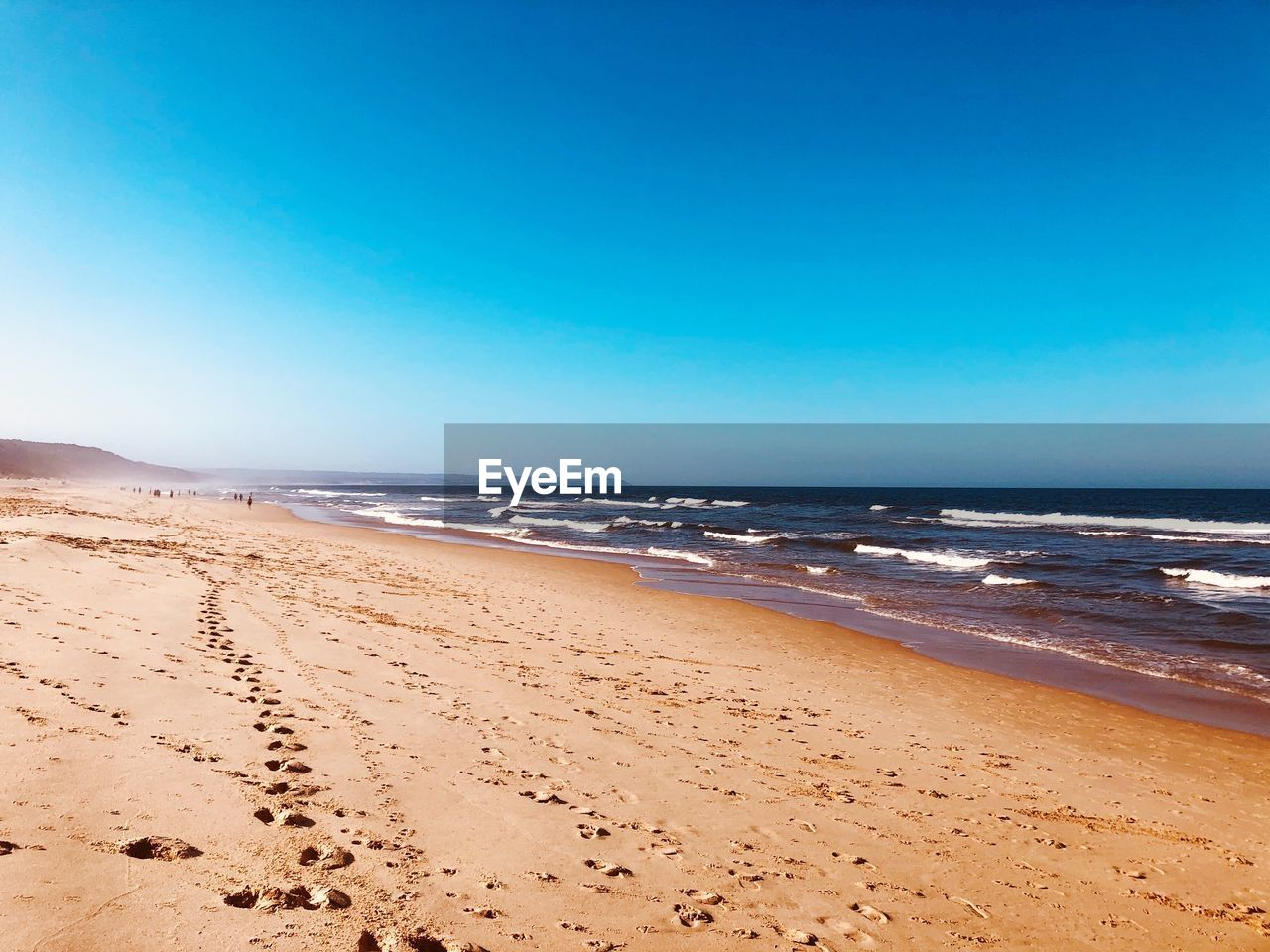sky, sea, water, beach, land, scenics - nature, sand, beauty in nature, horizon, tranquil scene, horizon over water, copy space, tranquility, clear sky, blue, nature, day, idyllic, no people, outdoors