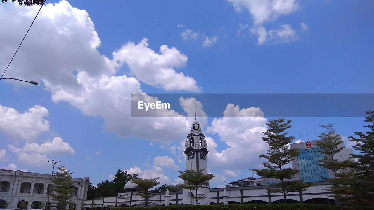 statue, human representation, sculpture, cloud - sky, sky, architecture, day, built structure, low angle view, building exterior, no people, outdoors, blue, travel destinations, tree