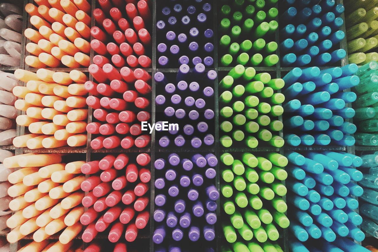 Full Frame Shot Of Colorful Pens In Rack For Sale