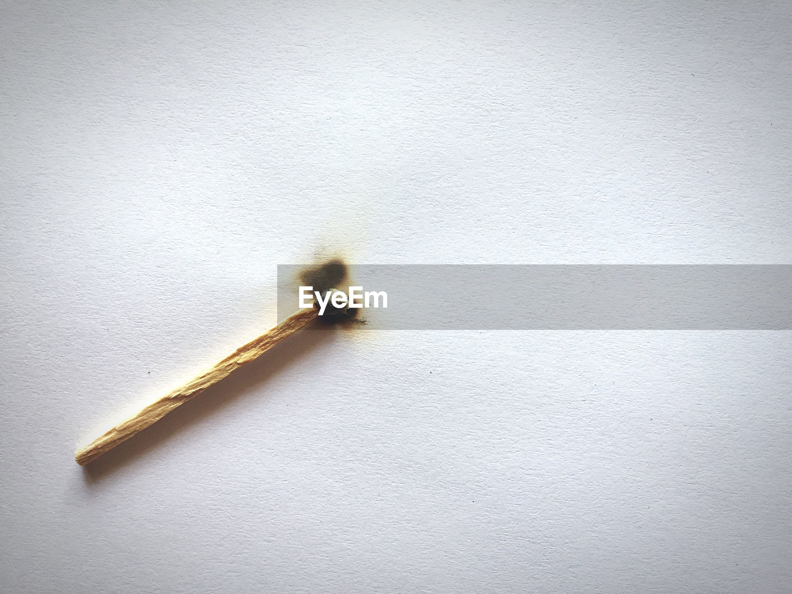 High angle view of matchstick on table