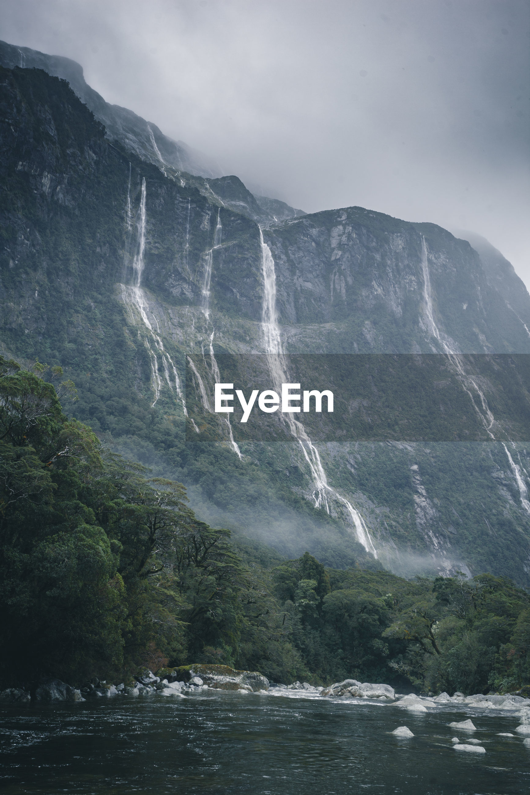 SCENIC VIEW OF WATERFALL ON MOUNTAIN