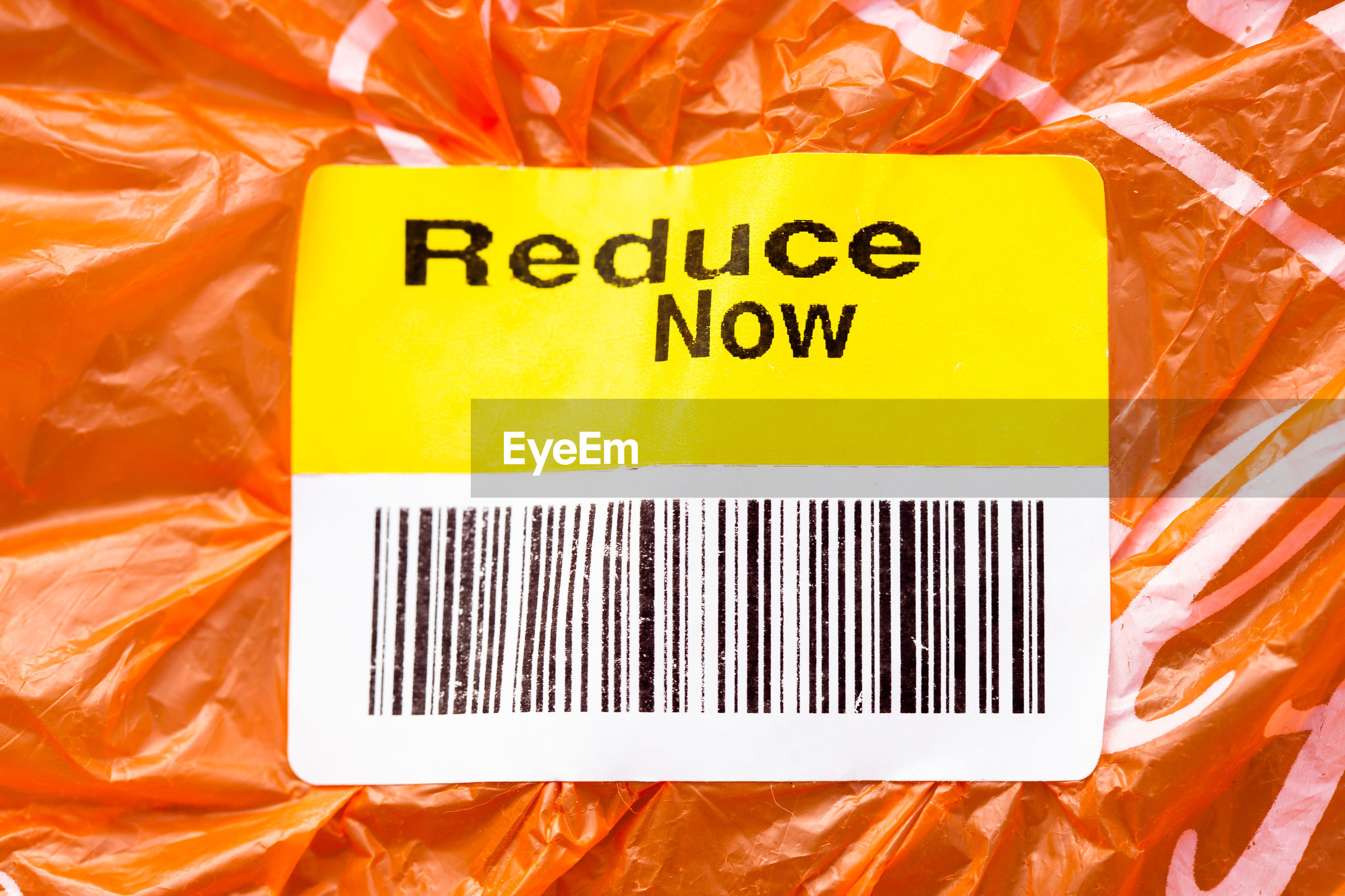 Close-up of bar code with text on orange plastic