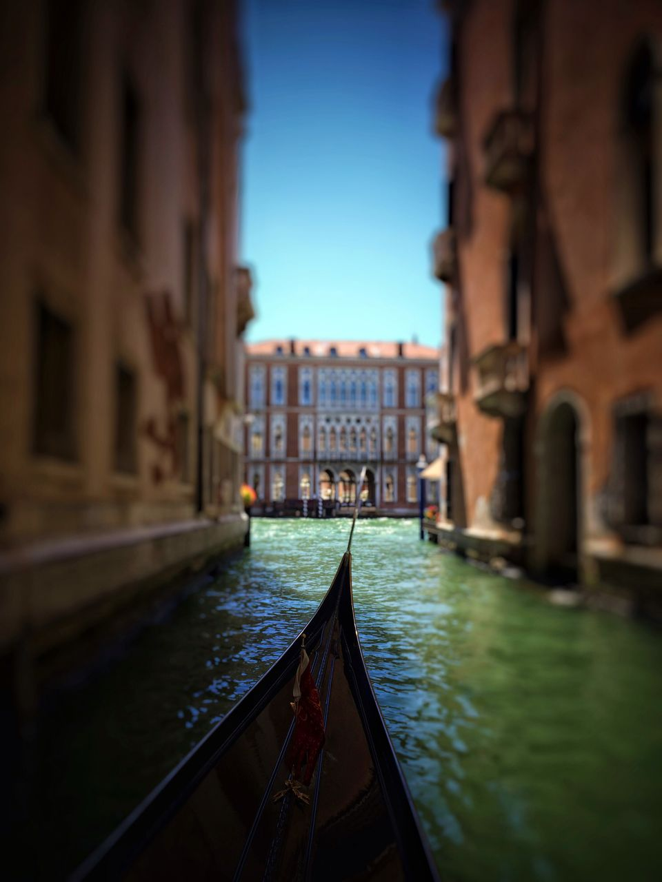 architecture, built structure, building exterior, canal, water, travel destinations, transportation, gondola, travel, gondola - traditional boat, nautical vessel, day, outdoors, city, sky, clear sky, no people, tilt-shift