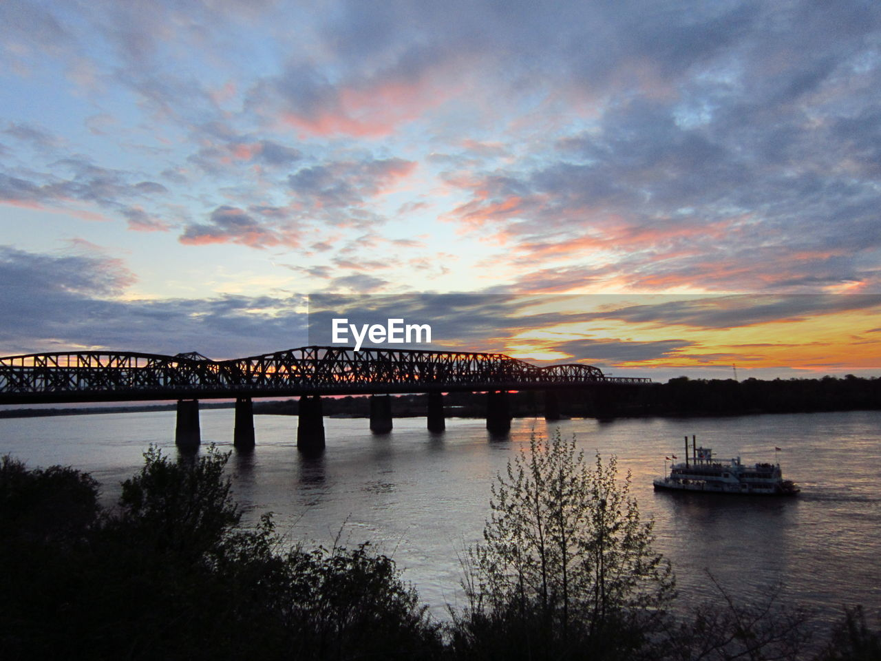 water, sky, sunset, bridge - man made structure, cloud - sky, river, transportation, built structure, architecture, nature, connection, scenics, beauty in nature, no people, nautical vessel, waterfront, travel destinations, outdoors, tranquility, city, day