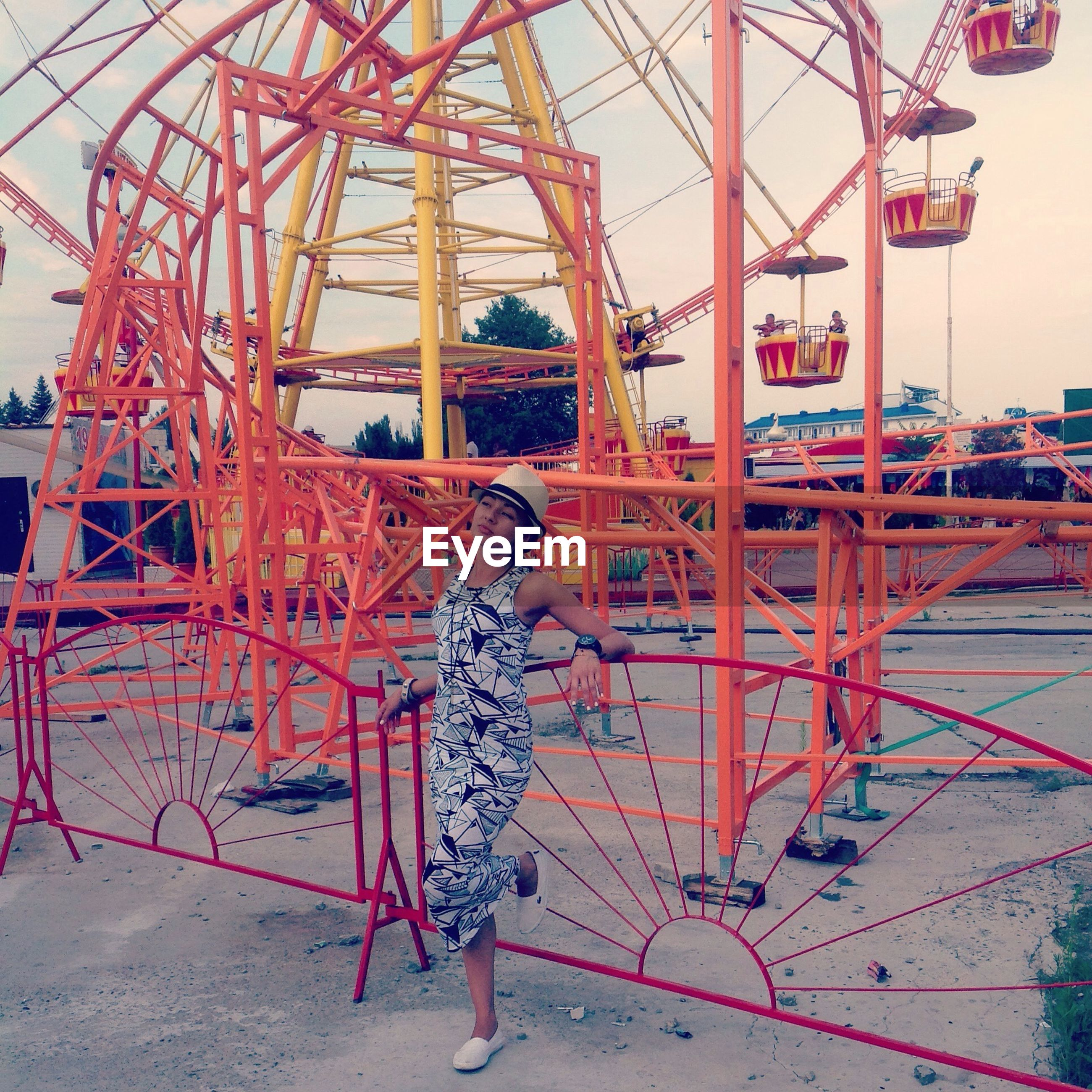 metal, transportation, amusement park, amusement park ride, metallic, built structure, low angle view, mode of transport, arts culture and entertainment, architecture, ferris wheel, red, travel, construction site, sky, day, outdoors, engineering, travel destinations, connection