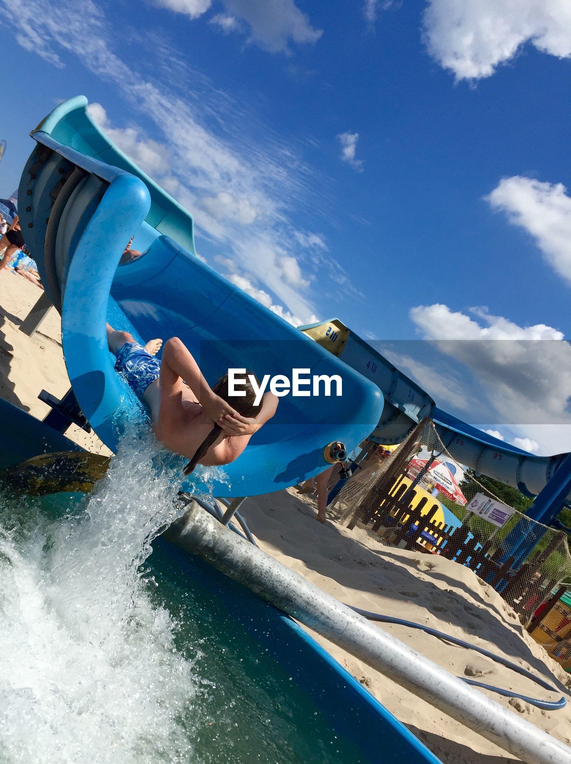 Man enjoying on slide at water park