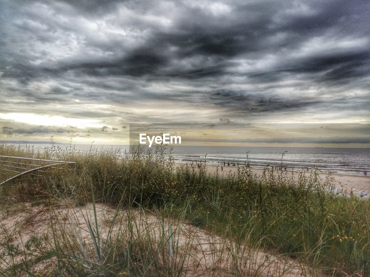 cloud - sky, sky, water, sea, beauty in nature, grass, beach, land, tranquility, tranquil scene, scenics - nature, nature, plant, horizon, marram grass, no people, horizon over water, growth, sand, outdoors, timothy grass