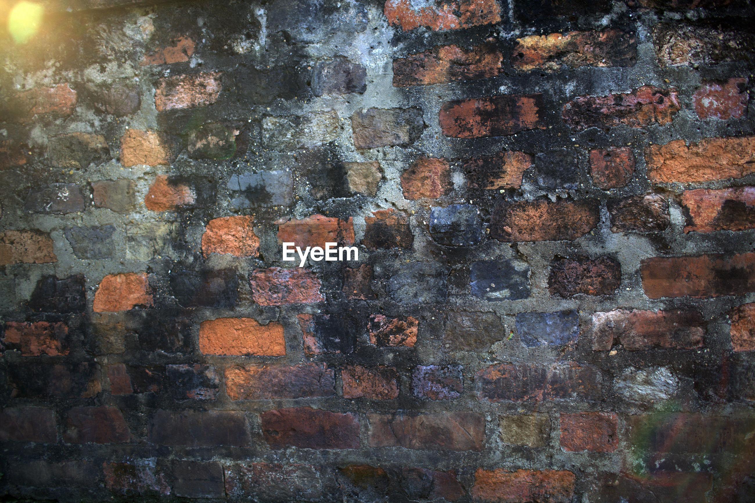 Full frame shot of weathered brick wall