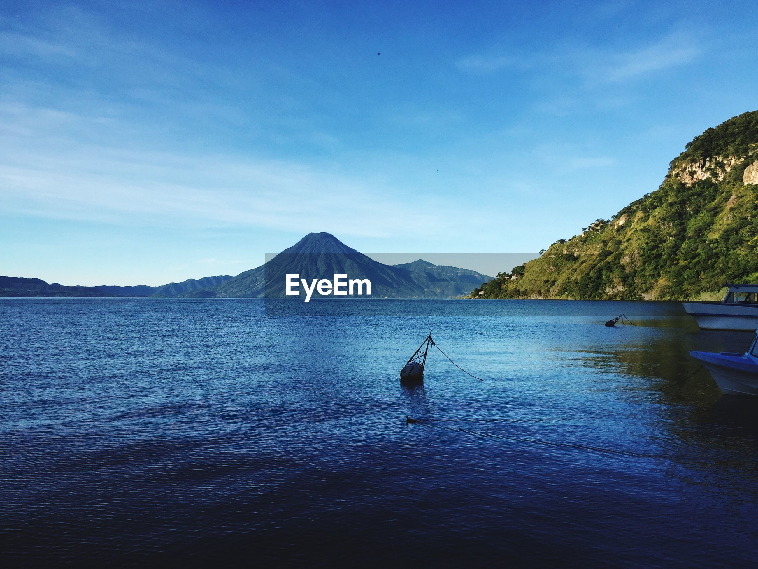 Scenic view of lake atitlan and mountains against sky
