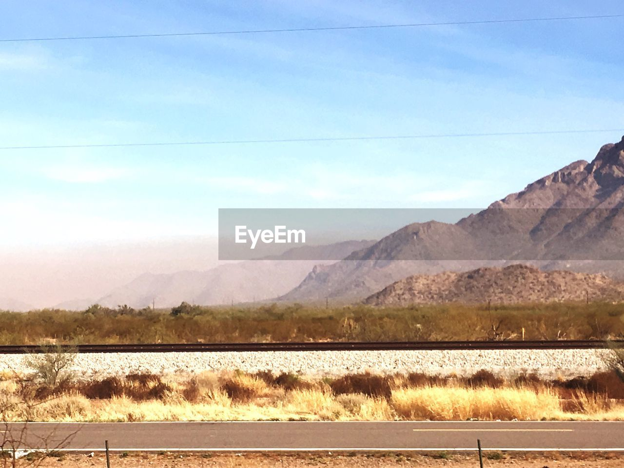 mountain, nature, scenics, tranquility, beauty in nature, mountain range, day, tranquil scene, outdoors, no people, water, salt flat, landscape, sky, road, lake, salt - mineral, salt basin