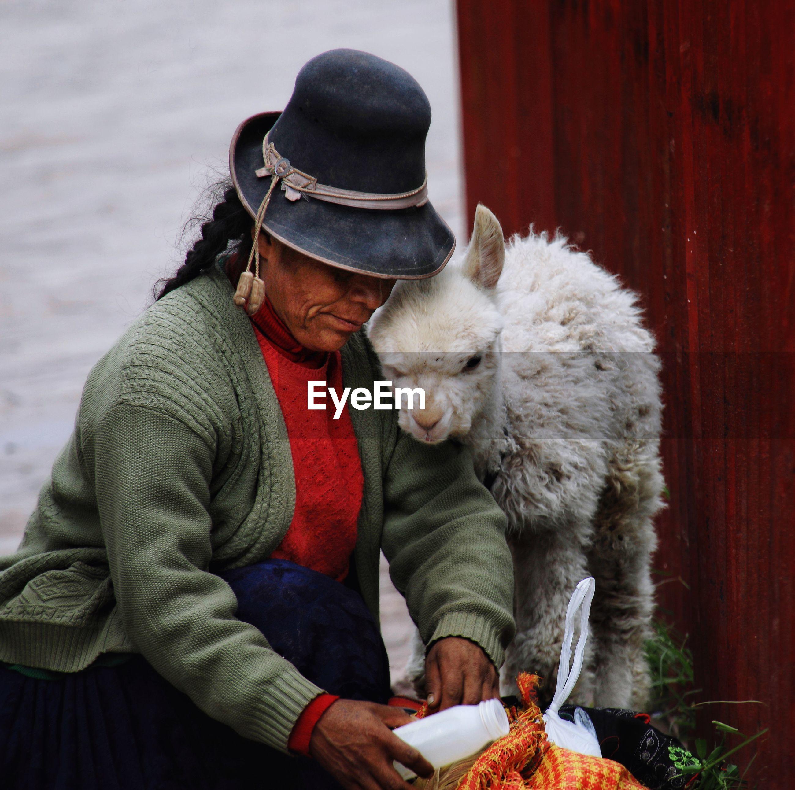 MAN HOLDING UMBRELLA IN WINTER
