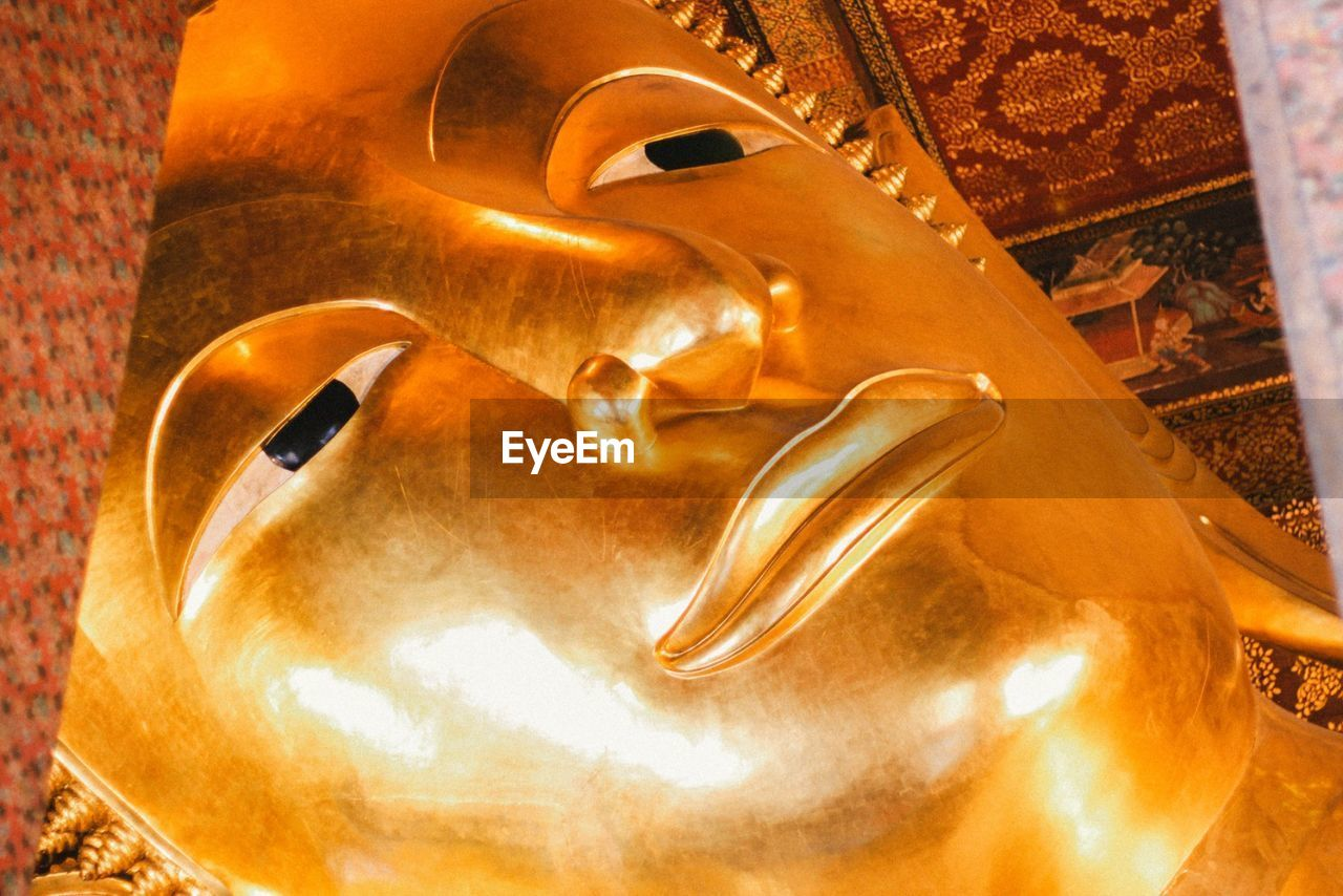 High Angle View Of Golden Buddha Statue In Temple