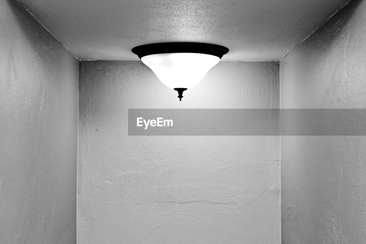 wall - building feature, lighting equipment, indoors, ceiling, built structure, illuminated, day, electricity, no people, architecture, low angle view, hanging, close-up