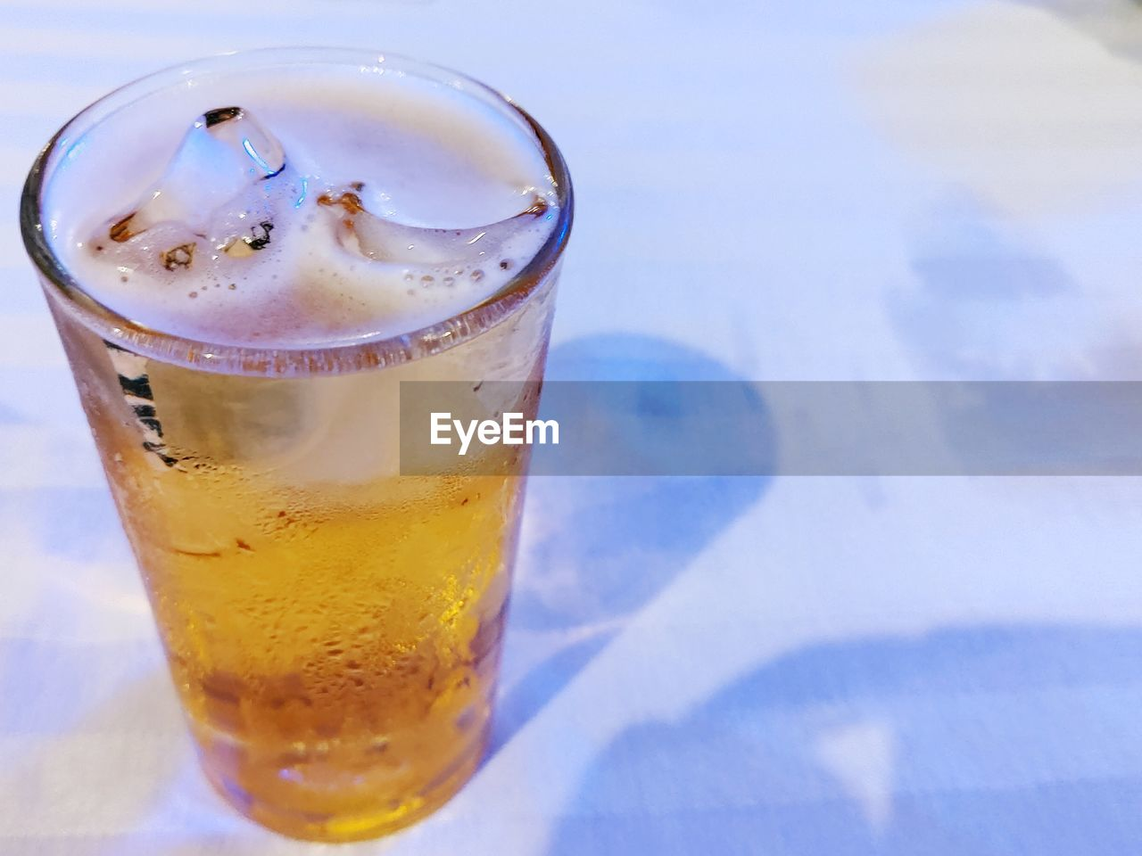 drink, food and drink, cold temperature, refreshment, glass, household equipment, freshness, drinking glass, table, close-up, frozen, no people, ice, still life, focus on foreground, glass - material, food, high angle view, indoors, transparent, temptation