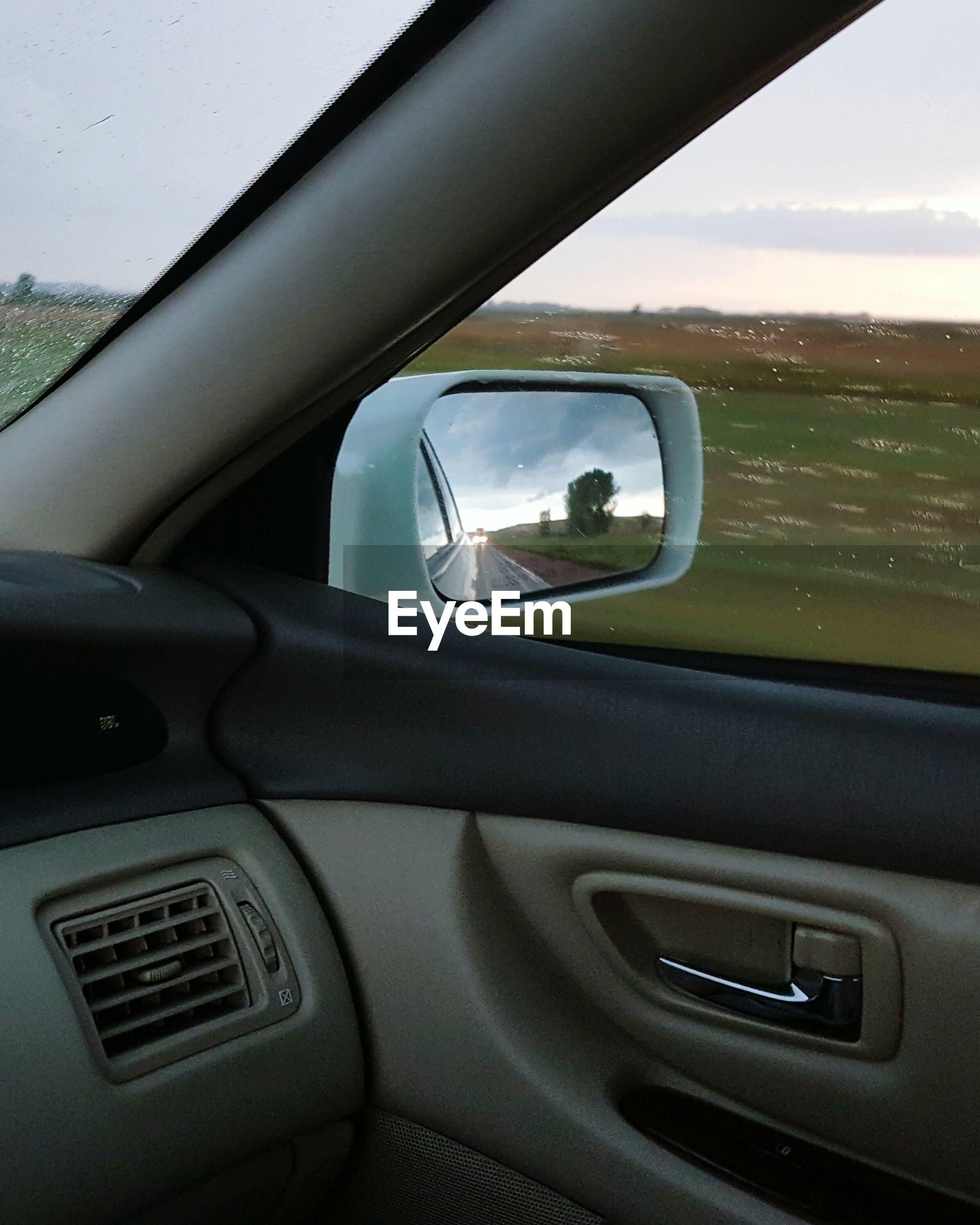 CLOSE-UP OF CAR ON WINDOW