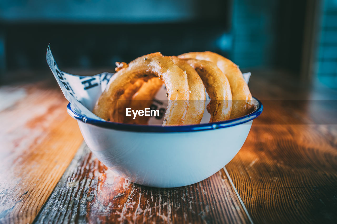 Close-Up Of Onion Rings In Bowl On Table