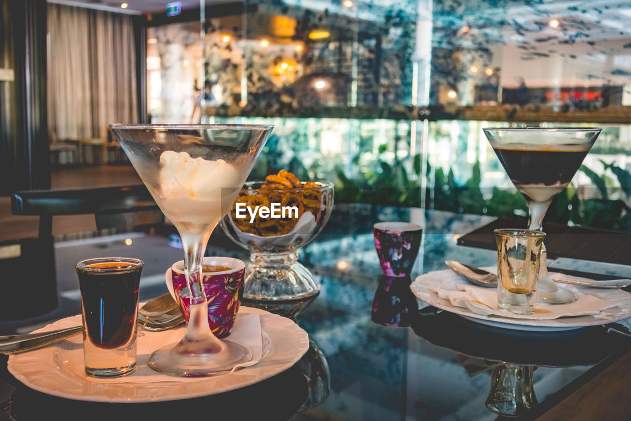food and drink, drink, refreshment, table, glass, freshness, alcohol, glass - material, martini glass, food, cocktail, drinking glass, transparent, no people, restaurant, household equipment, focus on foreground, close-up, still life, business, martini, tray, bar counter