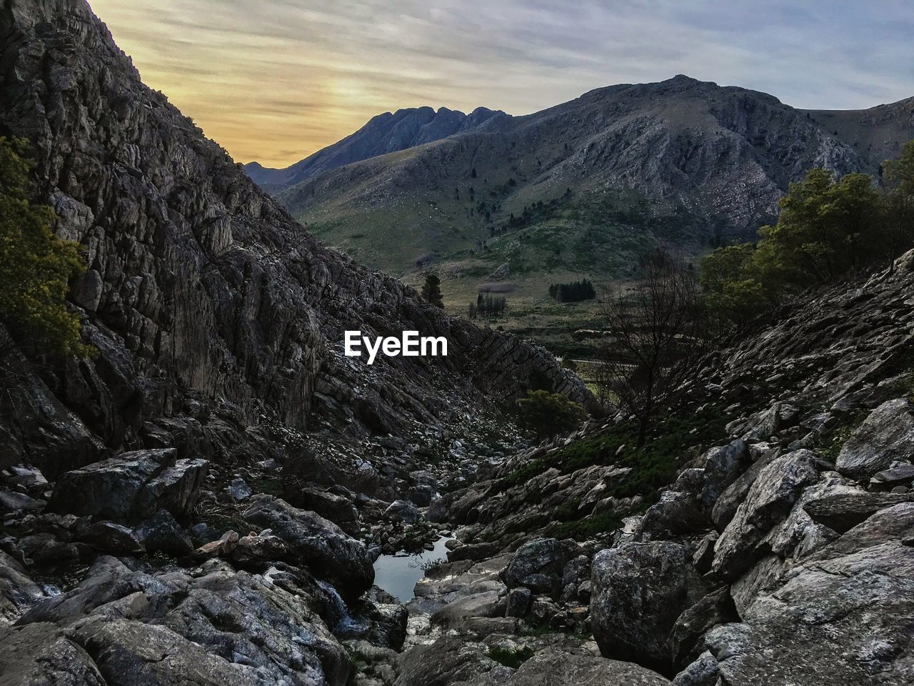 mountain, rock, mountain range, sky, scenics - nature, rock - object, environment, solid, nature, tranquil scene, beauty in nature, tranquility, landscape, no people, rock formation, cloud - sky, non-urban scene, geology, day, land, outdoors, formation, flowing water