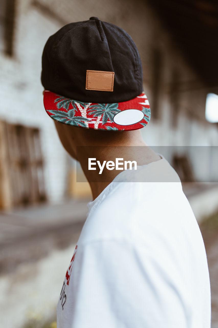Side View Of Man Wearing Cap