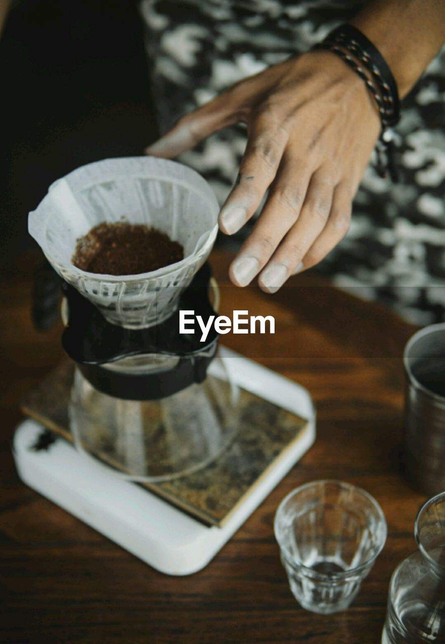 Cropped Hand Of Person Making Coffee At Home