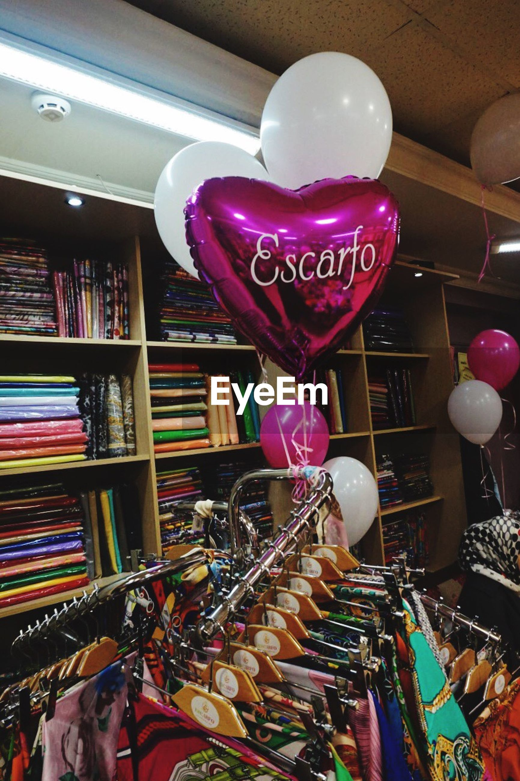 large group of objects, text, abundance, indoors, shelf, heart shape, balloon, for sale, choice, hanging, love, bookshelf, variation, arrangement, no people, retail, communication, store, multi colored, day, close-up