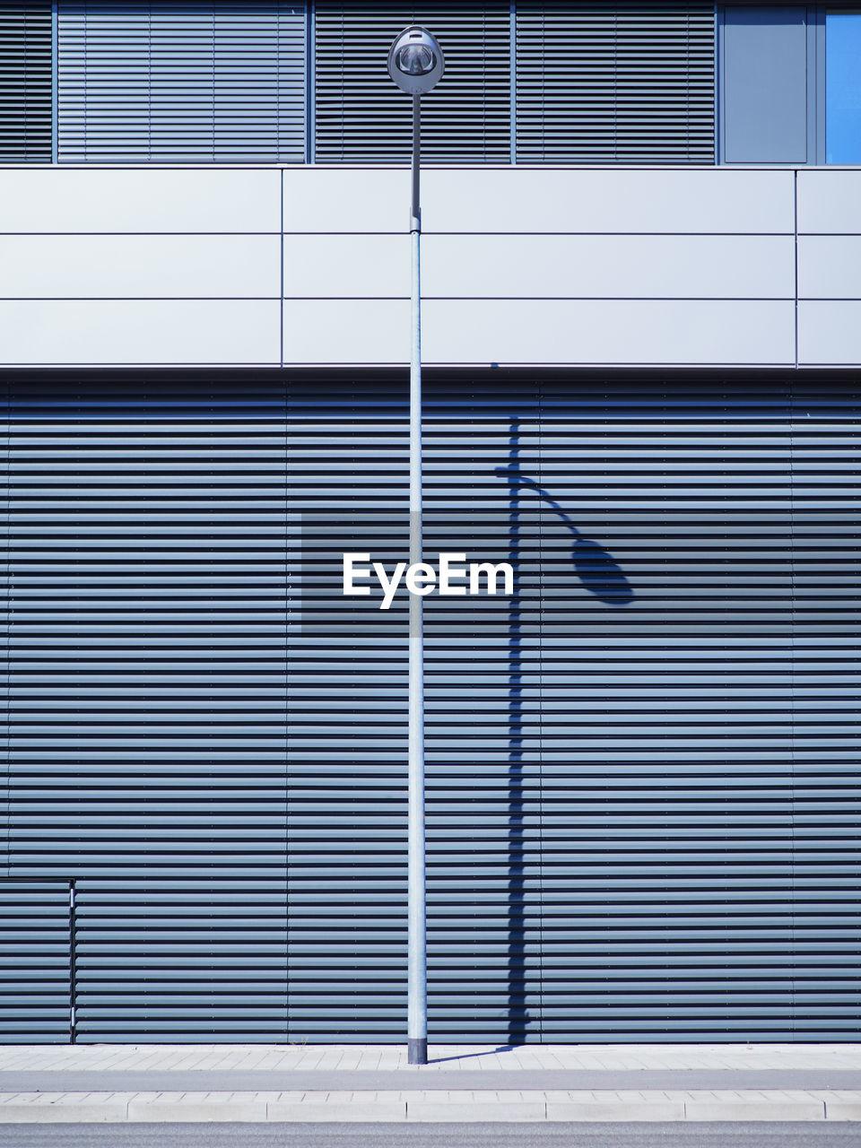 View Of Street Light Against Modern Building