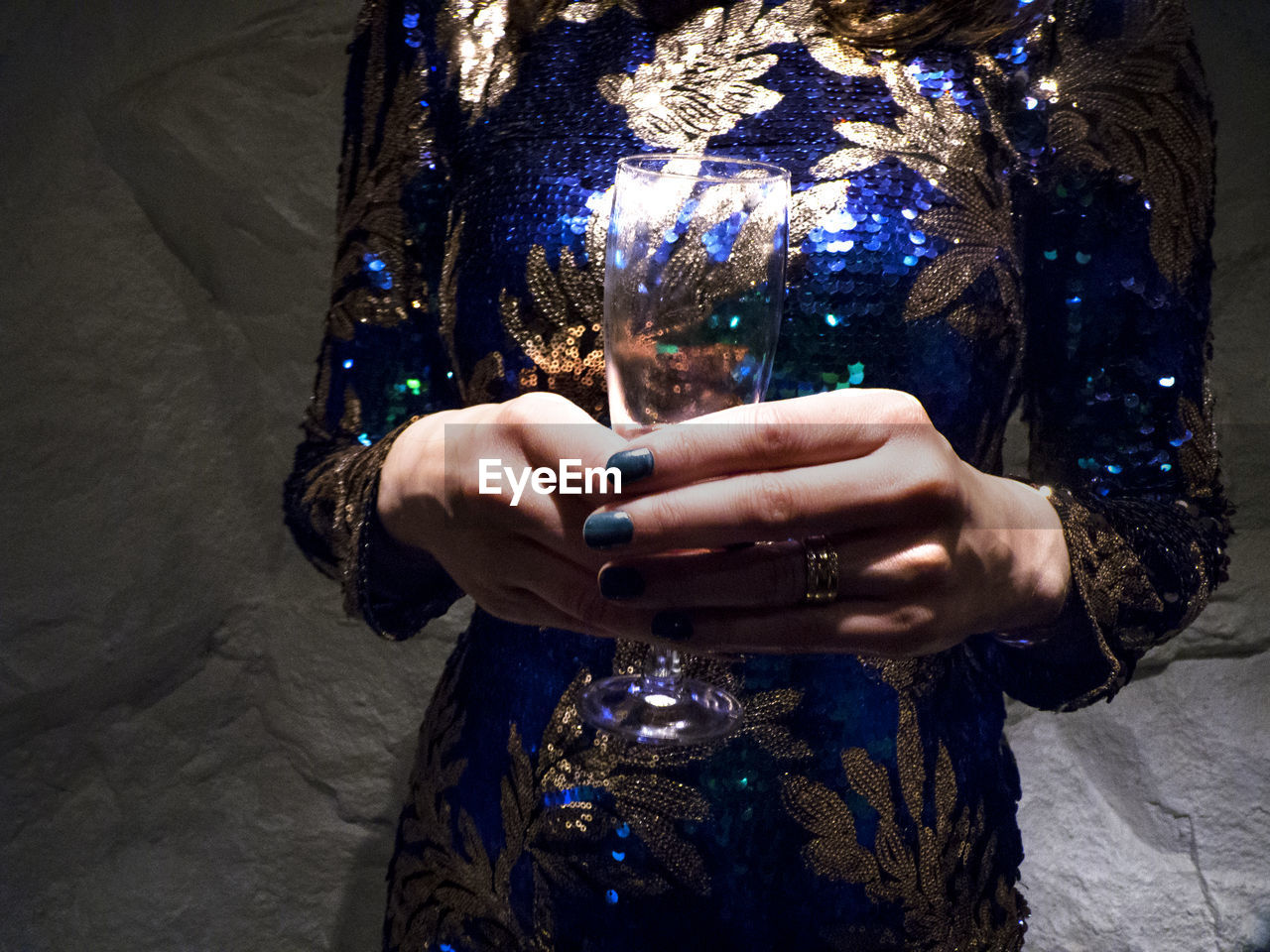 Midsection Of Woman Holding Drinking Glass