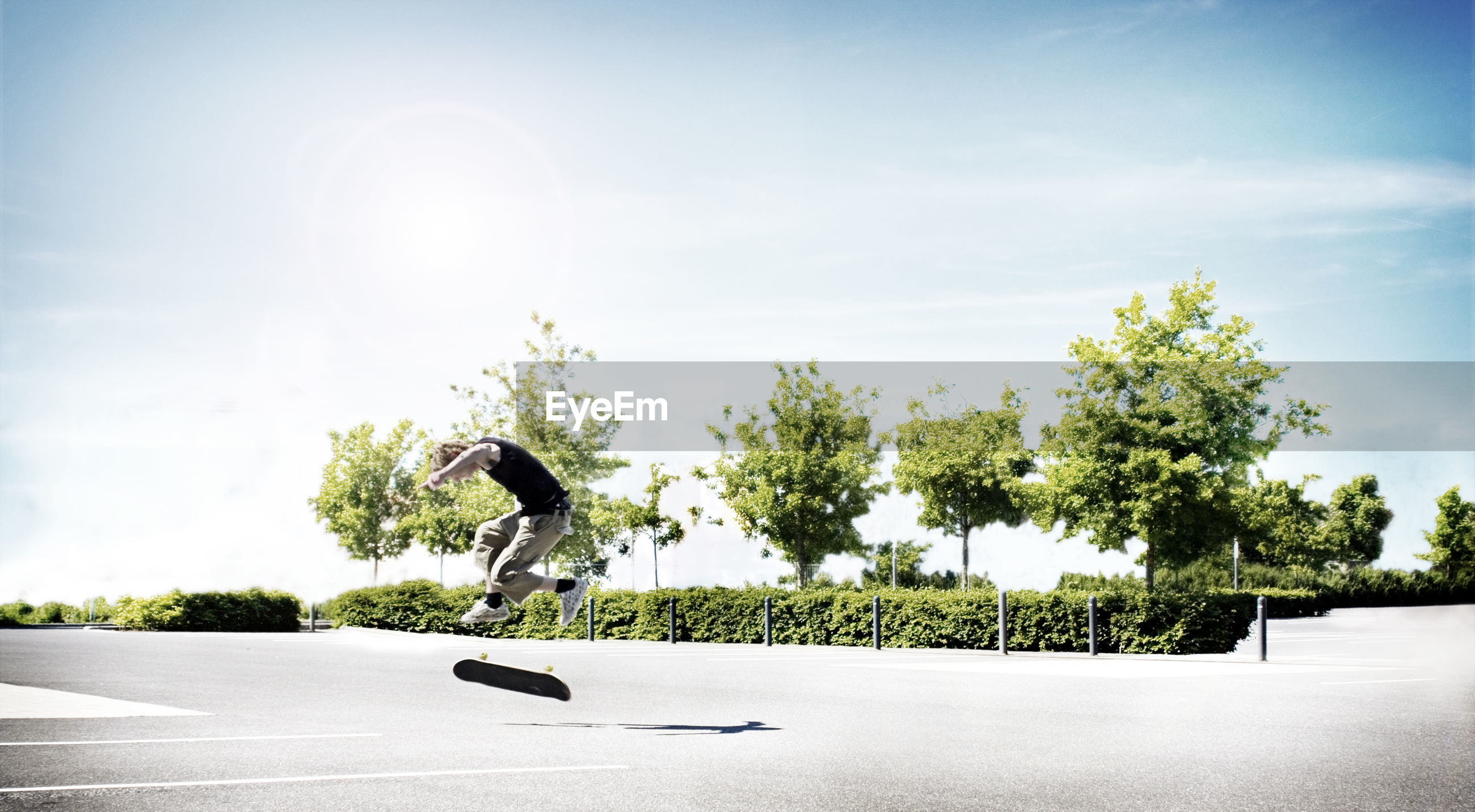 Man skateboarding against sky