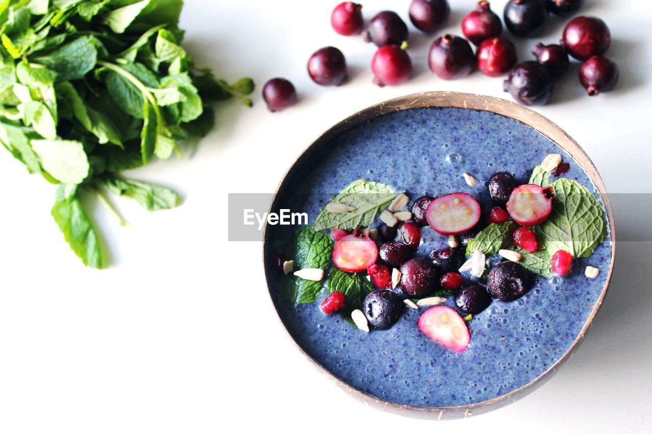 food, food and drink, healthy eating, fruit, wellbeing, berry fruit, freshness, bowl, still life, blueberry, indoors, table, high angle view, no people, directly above, close-up, studio shot, breakfast, plant, large group of objects