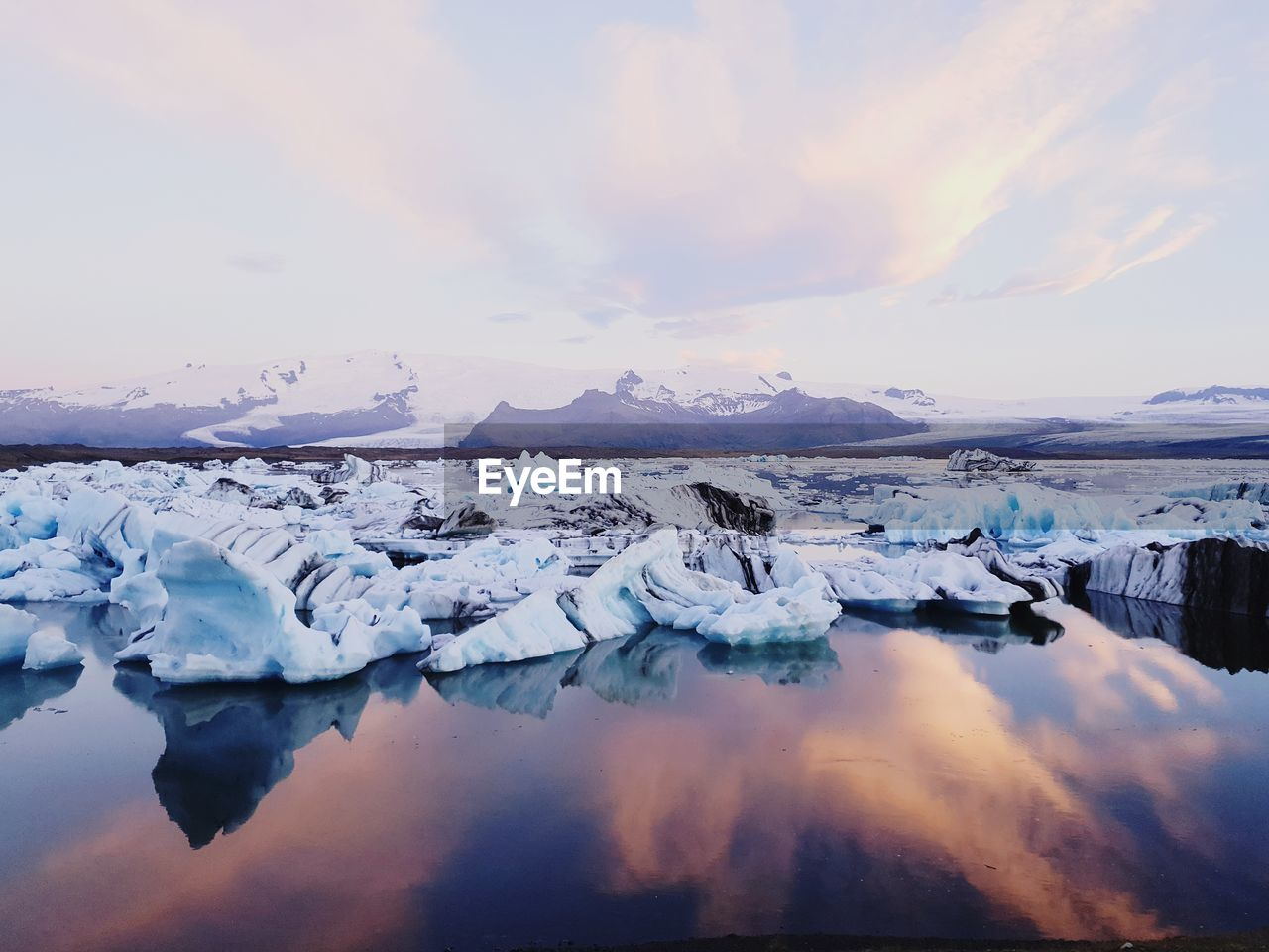cold temperature, ice, water, sky, glacier, beauty in nature, scenics - nature, winter, cloud - sky, environment, tranquility, tranquil scene, iceberg, frozen, landscape, sunset, idyllic, reflection, no people, floating on water, snowcapped mountain, melting, lagoon