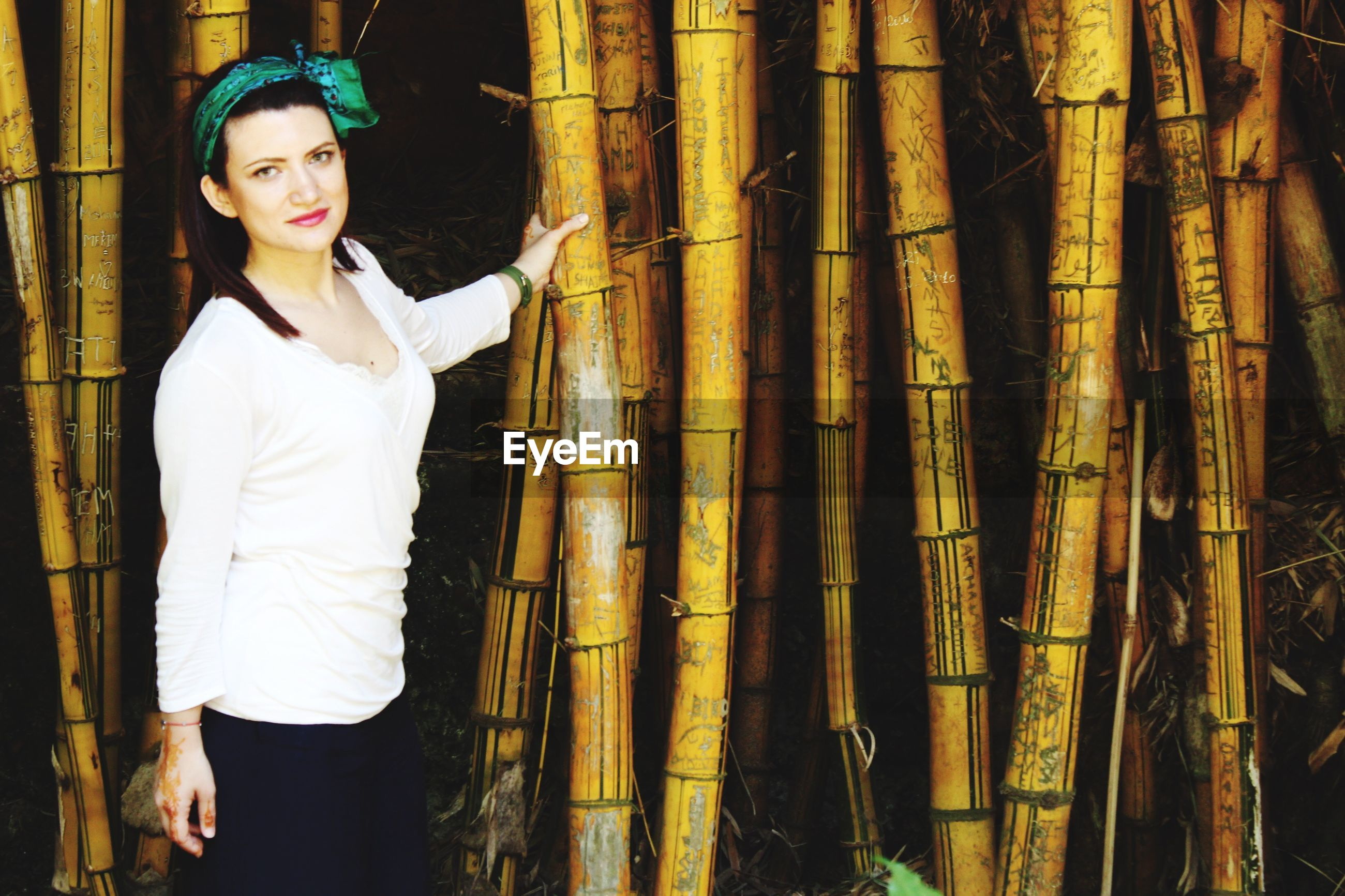 Portrait of woman standing in bamboo forest