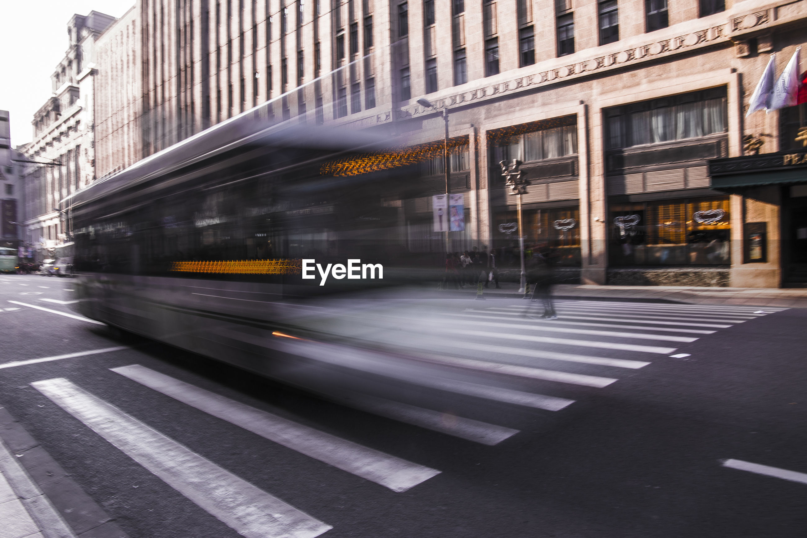 Blurred motion of bus on road in city