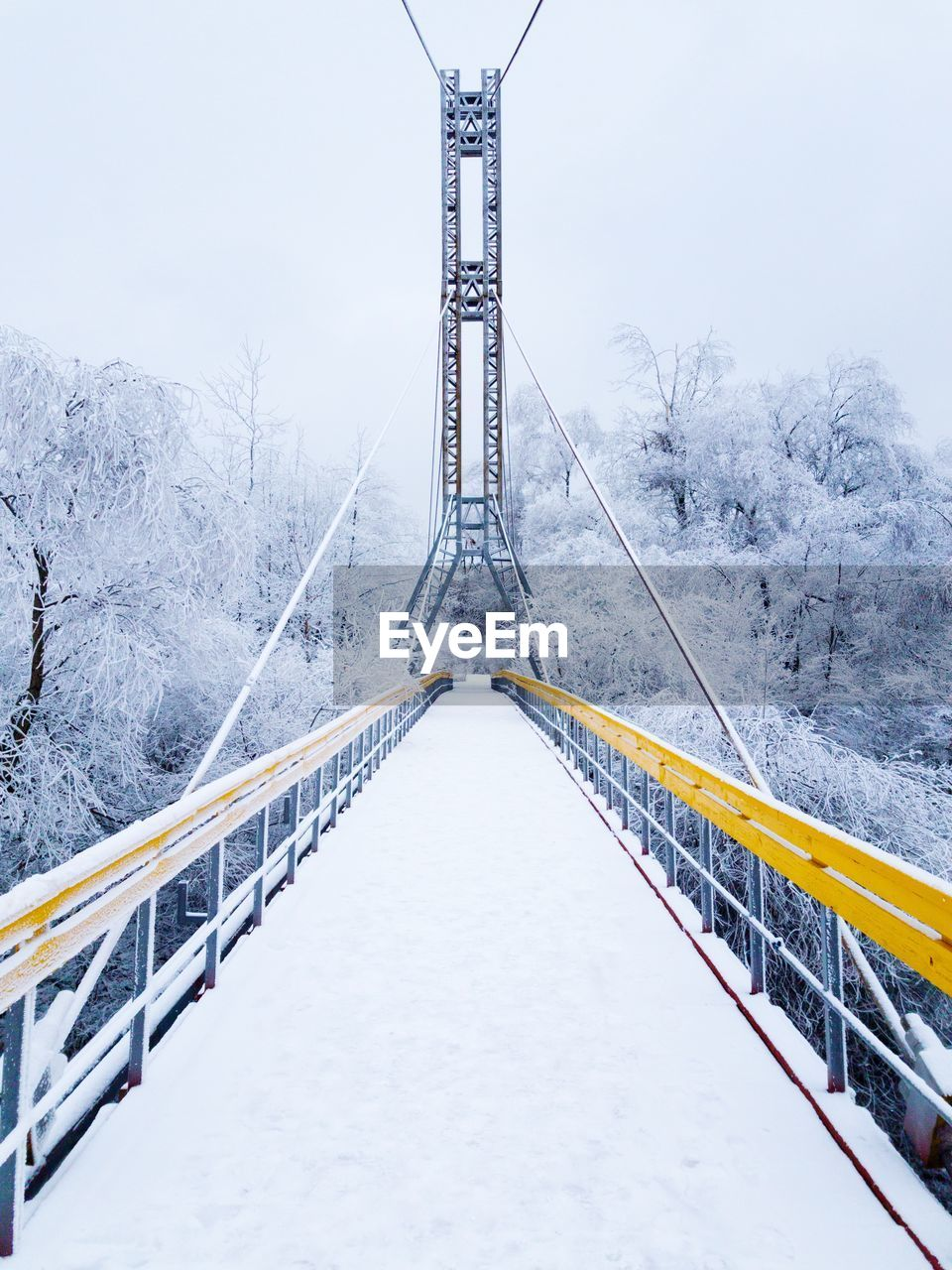 snow, winter, connection, cold temperature, bridge - man made structure, weather, the way forward, day, outdoors, nature, no people, transportation, suspension bridge, cable, fog, sky, architecture, beauty in nature