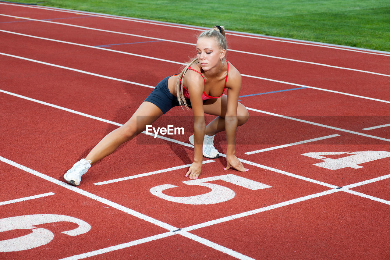 track and field, sport, running track, competition, running, young adult, lifestyles, sports race, sports track, exercising, full length, women, one person, healthy lifestyle, number, adult, athlete, track and field athlete, competitive sport, outdoors, track starting block