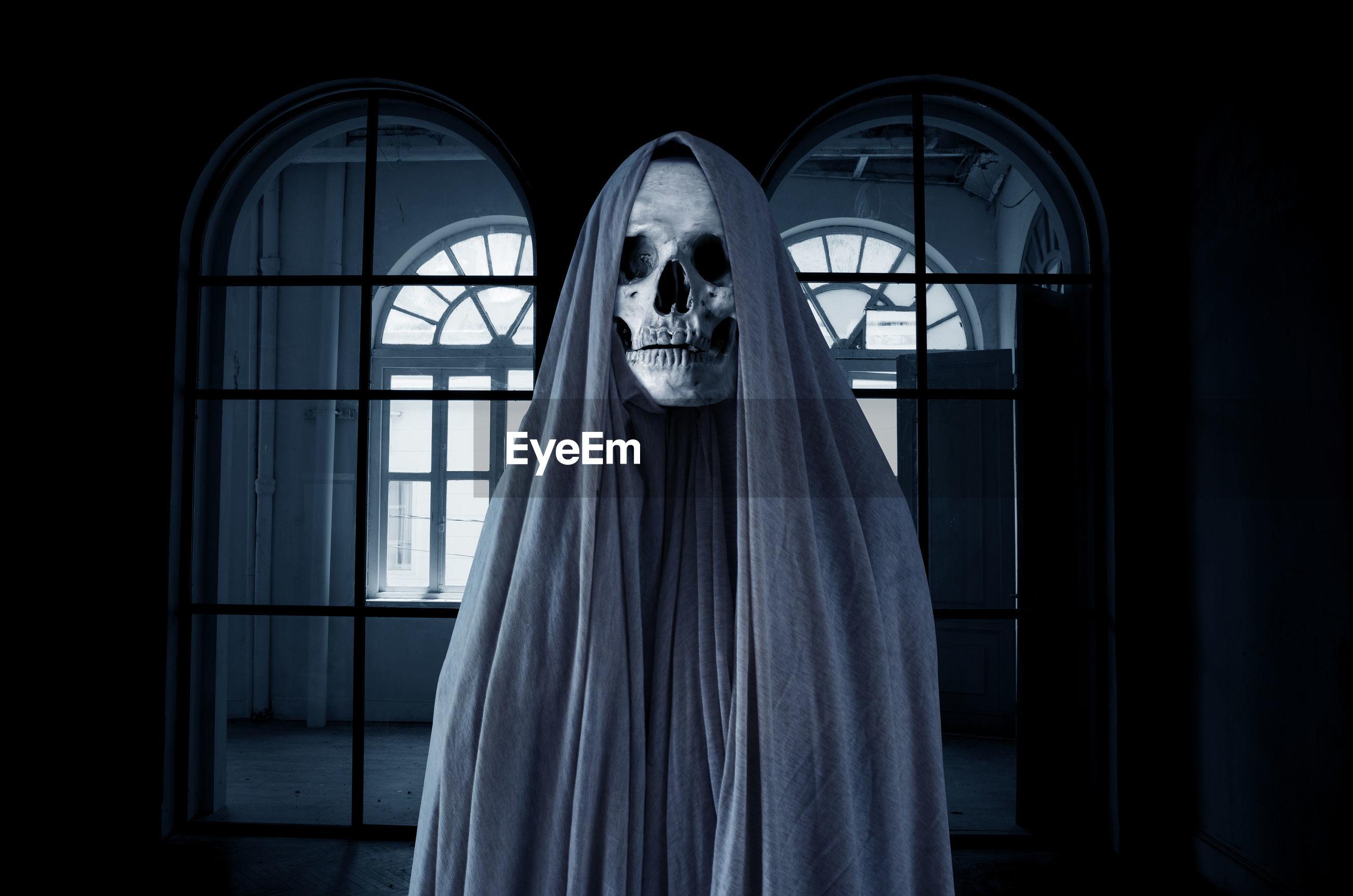 Spooky skull in empty dark room