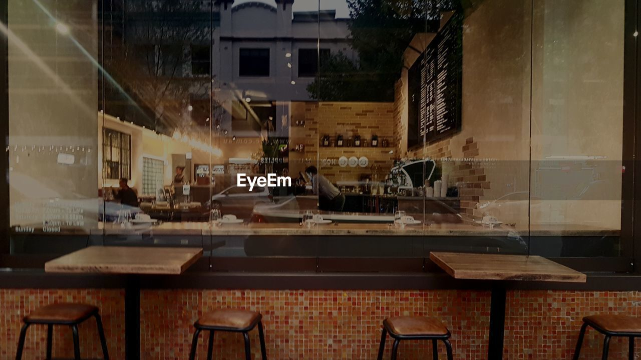 table, chair, indoors, restaurant, architecture, no people, commercial kitchen, illuminated, day