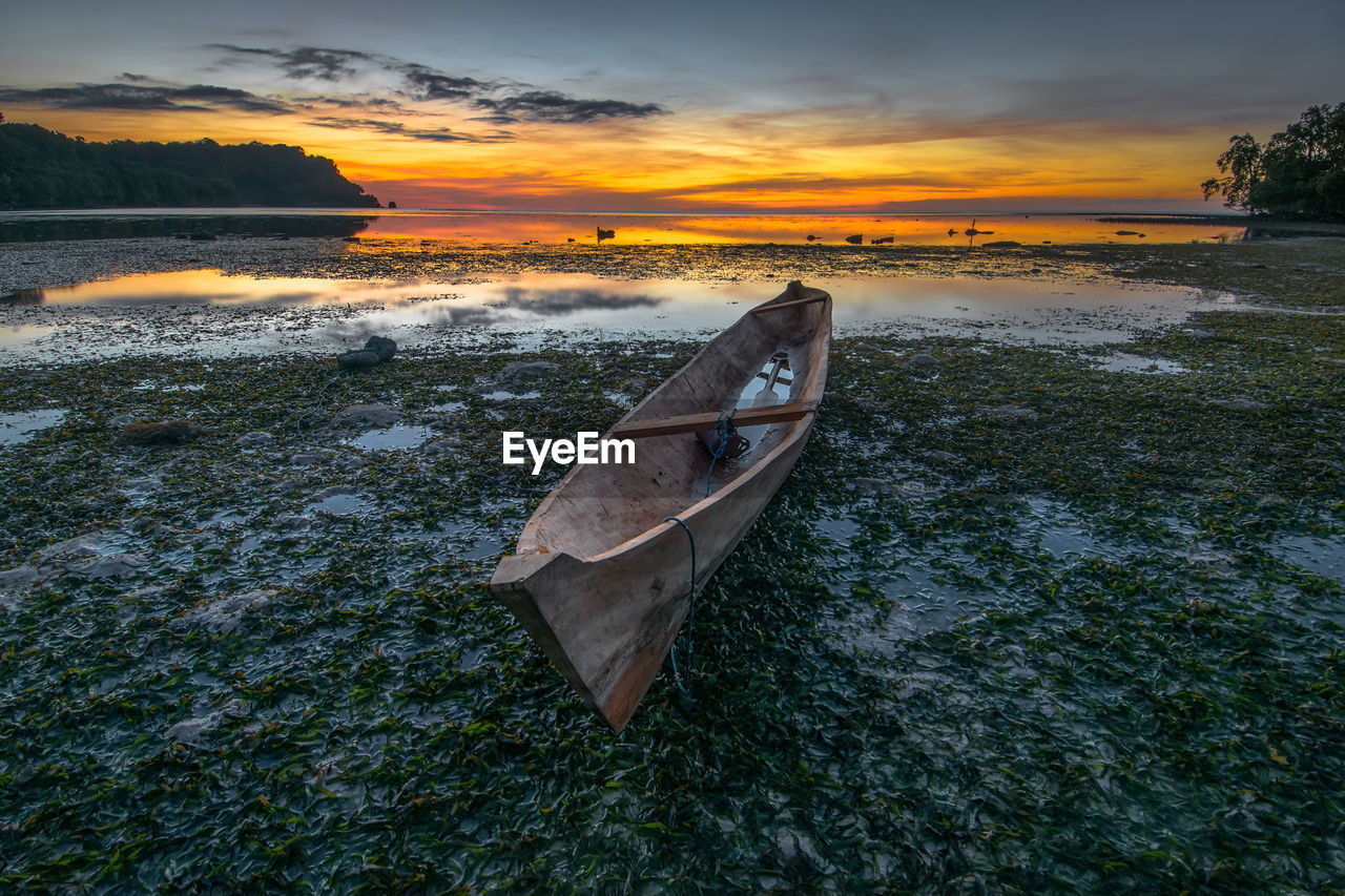 sunset, sky, water, cloud - sky, beauty in nature, nautical vessel, transportation, scenics - nature, nature, mode of transportation, tranquility, land, beach, no people, tranquil scene, lake, orange color, outdoors, non-urban scene