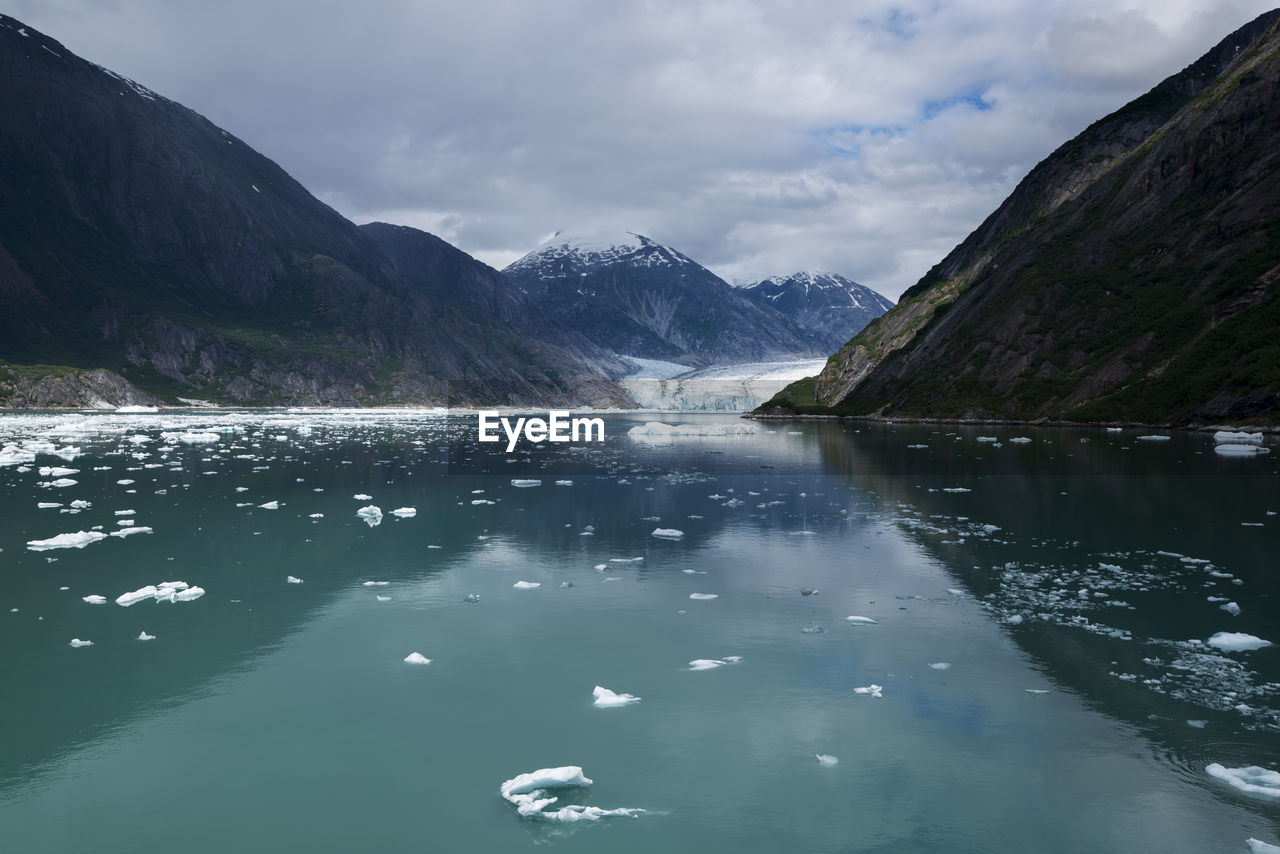 Scenic view of an alaskan glacier and mountains against sky
